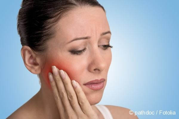 pain in the gums wisdom tooth during its growth