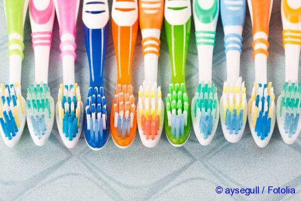 buy a brush to clean the teeth
