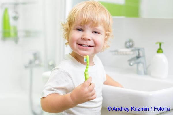 a two-year kid brushing his teeth
